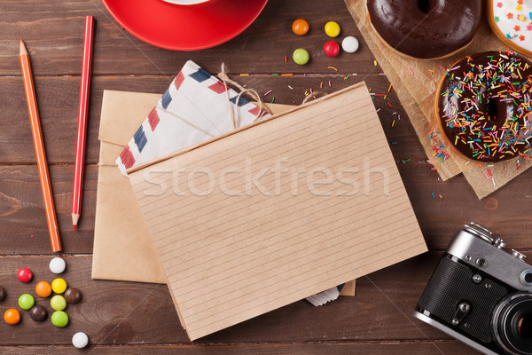 Notepad, donuts and coffee on wooden table Stock photo © karandaev