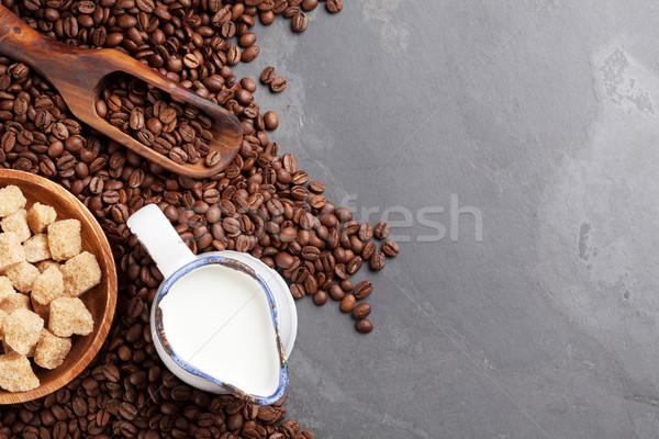 Coffee beans, milk and brown sugar Stock photo © karandaev