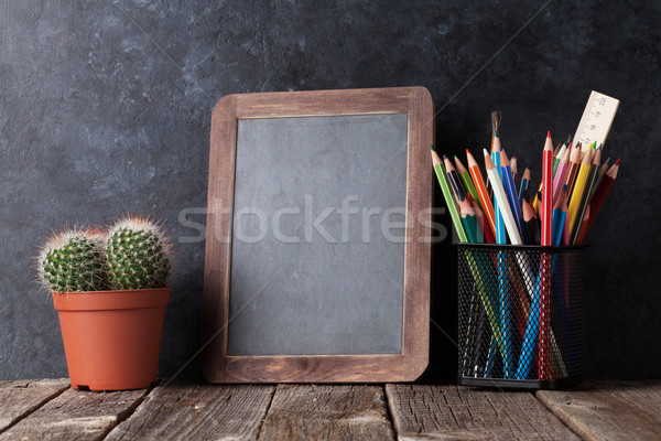 Supplies, cactus and chalk board Stock photo © karandaev