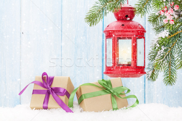 Christmas candle lantern, gift boxes and fir tree Stock photo © karandaev
