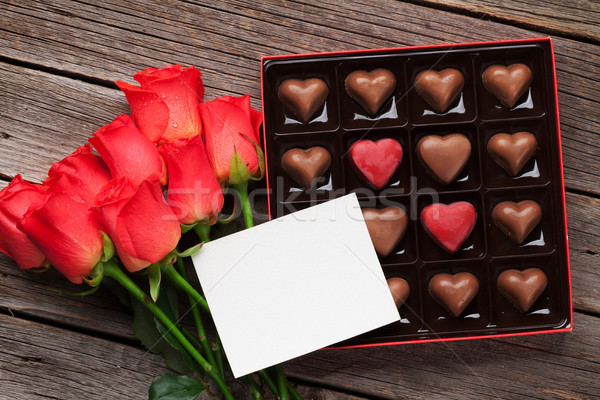 Valentines day with red roses and chocolate Stock photo © karandaev