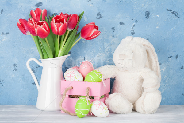 Red tulip flowers, eggs and easter rabbit toy Stock photo © karandaev
