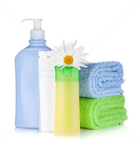 Shampoo gel bottiglie asciugamani fiore isolato Foto d'archivio © karandaev