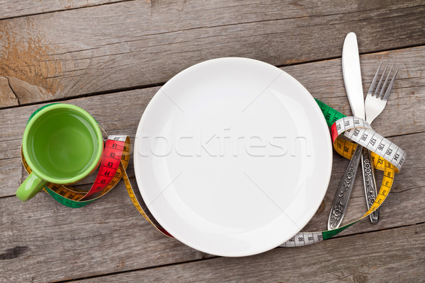 Plate with measure tape, cup, knife and fork. Diet food Stock photo © karandaev