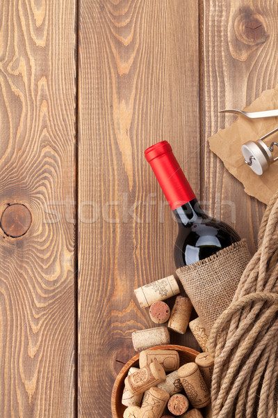 Red wine bottle, corks and corkscrew Stock photo © karandaev