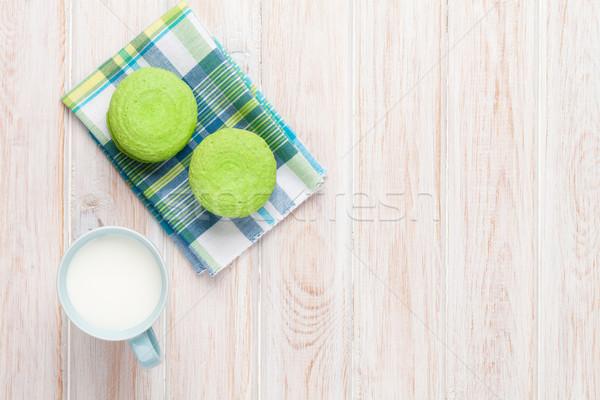 Renkli macarons fincan süt beyaz ahşap masa Stok fotoğraf © karandaev