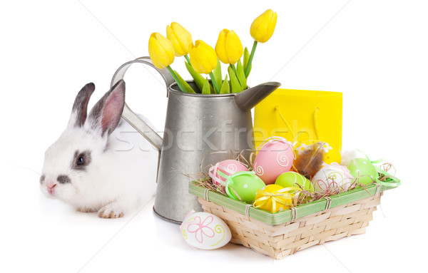 Easter with colorful eggs, yellow tulips and rabbit Stock photo © karandaev