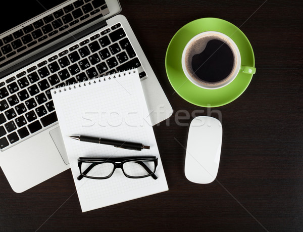 Office desk table with computer, supplies, coffee and glasses Stock photo © karandaev