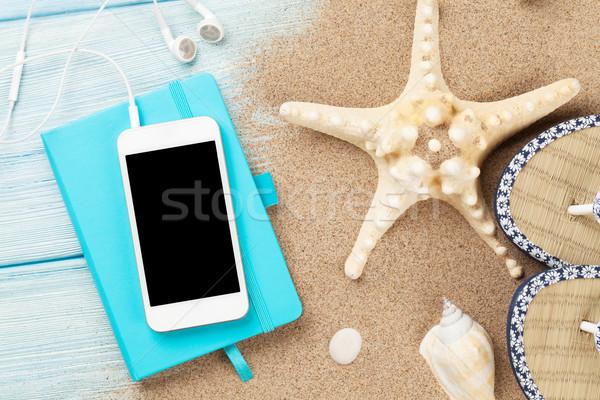 Smartphone notepad hout zeester schelpen houten tafel Stockfoto © karandaev