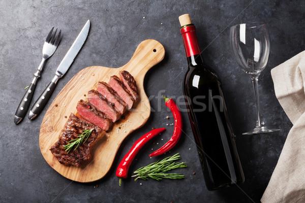 Grilled striploin steak and wine Stock photo © karandaev