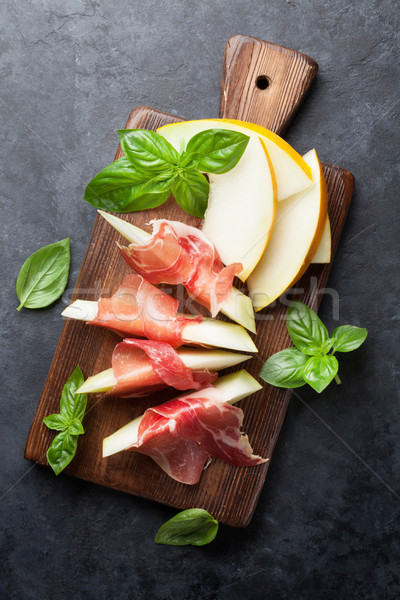 Melon with prosciutto and basil Stock photo © karandaev