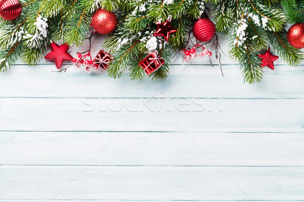 Christmas background with snow fir tree Stock photo © karandaev