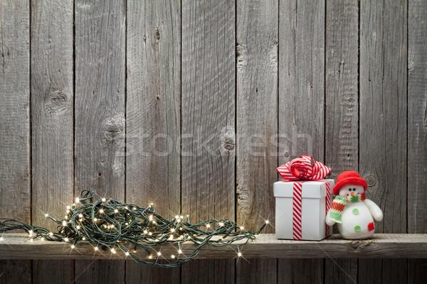Natal luzes caixa de presente boneco de neve brinquedo Foto stock © karandaev