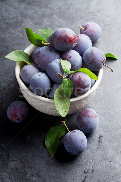 Garden plums in bowl Stock photo © karandaev
