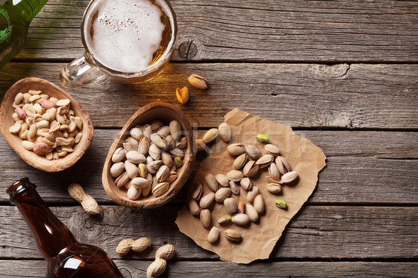 Lager beer and nuts Stock photo © karandaev
