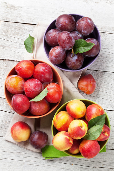 Fresh ripe peaches and plums Stock photo © karandaev