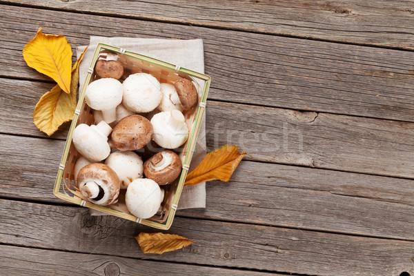 Champiñón setas cuadro mesa de madera superior vista Foto stock © karandaev