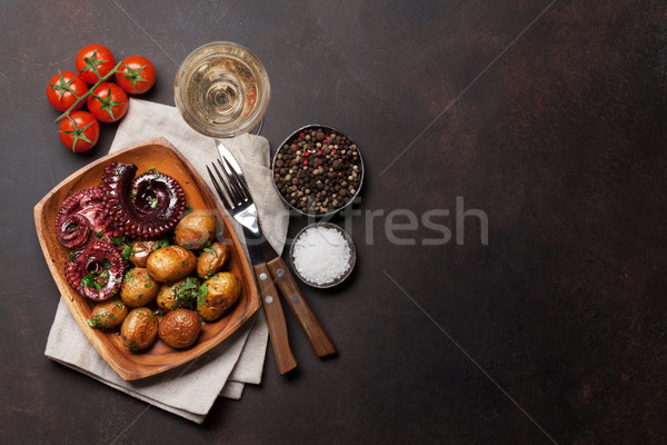 Grilled octopus with small potatoes and wine Stock photo © karandaev
