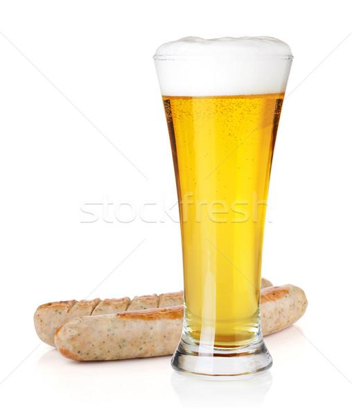 Világos sör üveg kettő grillezett kolbászok hideg Stock fotó © karandaev