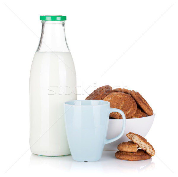 Cup, bottle of milk and bowl with cookies Stock photo © karandaev