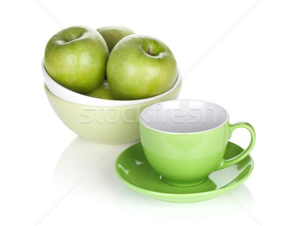 Green apples in fruit bowl and tea cup Stock photo © karandaev