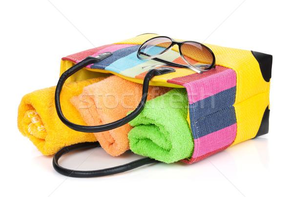 Beach bag with towels and sunglasses Stock photo © karandaev
