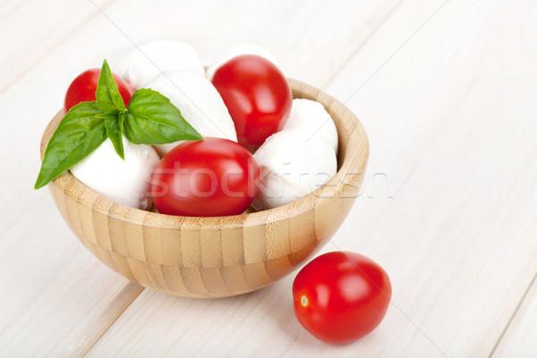 Mozzarella sajt koktélparadicsom bazsalikom fehér fa asztal Stock fotó © karandaev
