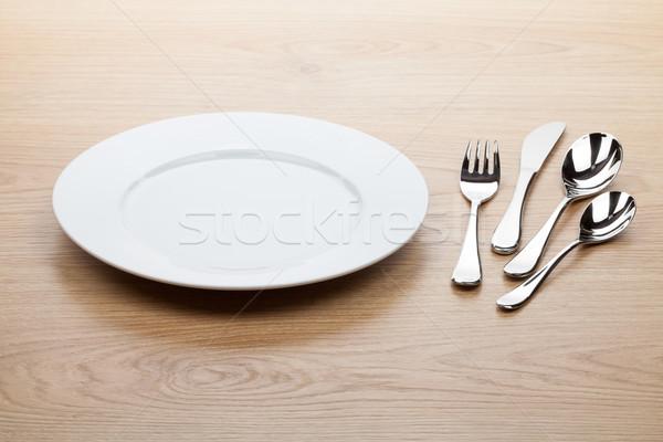 üres fehér tányér ezüst étkészlet fa asztal étel Stock fotó © karandaev