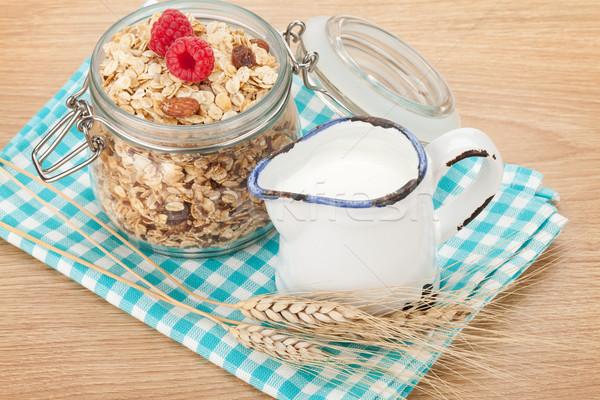Stock photo: Healty breakfast with muesli, berries and milk
