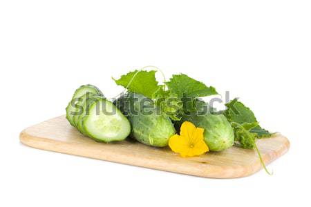 Ripe sliced cucumber on cutting board Stock photo © karandaev