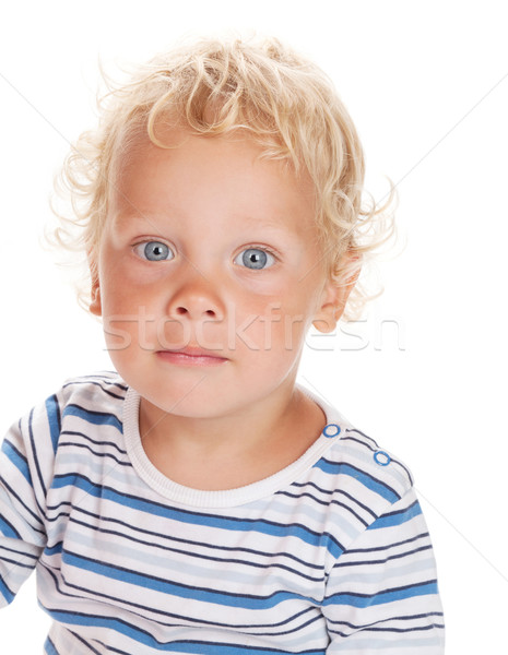 Blanco pelo rizado ojos azules bebé aislado sonrisa Foto stock © karandaev