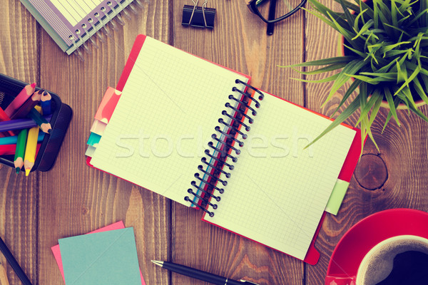 Office table with flower, blank notepad and coffee cup Stock photo © karandaev
