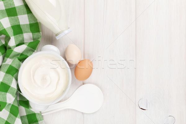 śmietana puchar mleka butelki drewniany stół górę Zdjęcia stock © karandaev