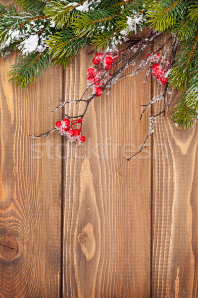 Christmas wooden background with snow fir tree Stock photo © karandaev