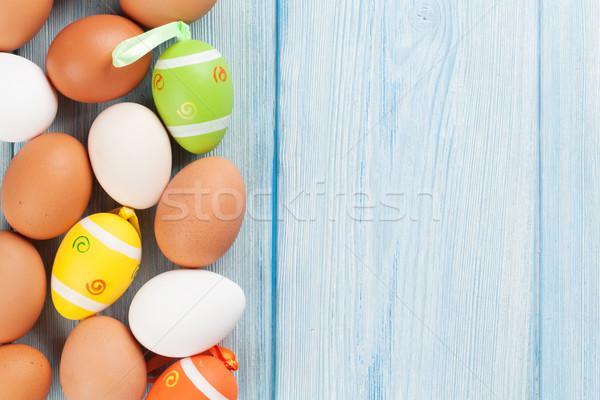 Húsvét színes tojások kék fa asztal felső Stock fotó © karandaev