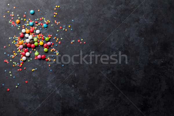 Colorful candies over stone Stock photo © karandaev