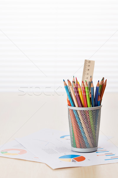 Office desk with charts and supplies Stock photo © karandaev