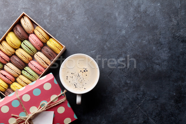 Colorful macaroons and coffee Stock photo © karandaev