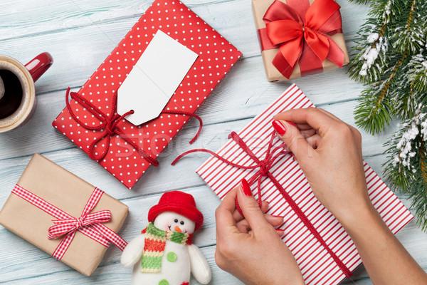 Female hands wrapping xmas gift Stock photo © karandaev