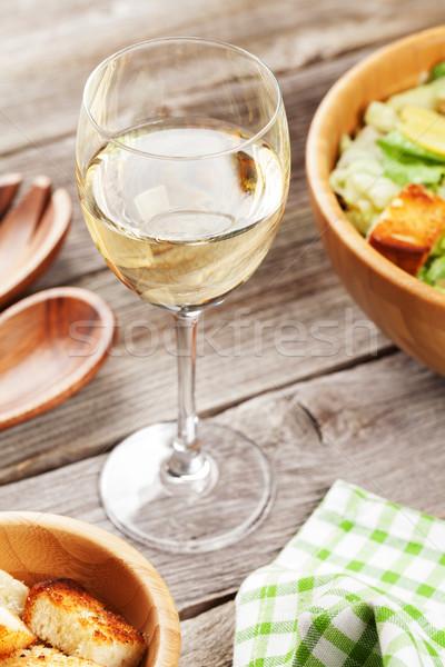 Fresh salad and white wine Stock photo © karandaev