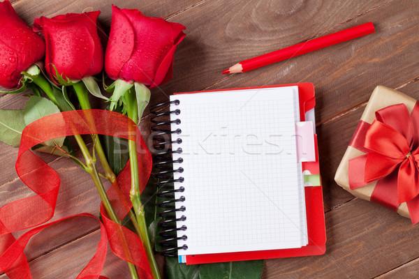 Love letter notepad, red roses and gift box Stock photo © karandaev