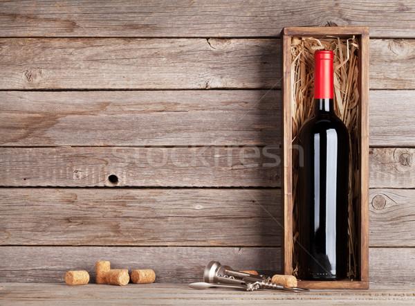 Red wine bottle in box Stock photo © karandaev