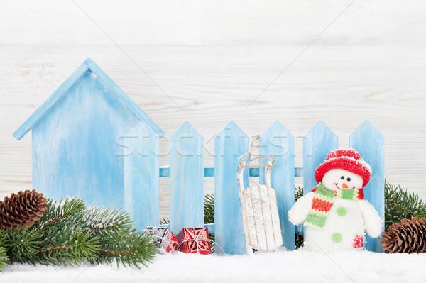 Karácsony ajándékdobozok hóember játék fenyőfa ág Stock fotó © karandaev
