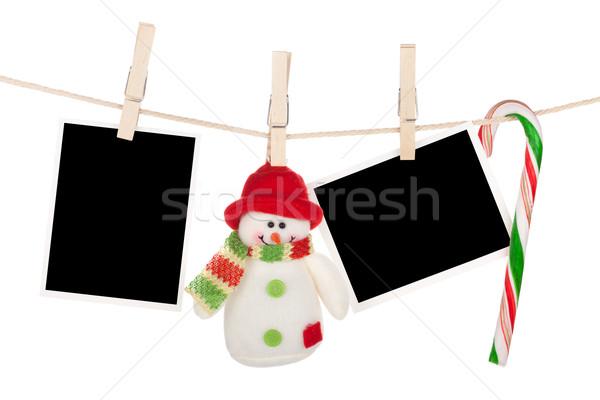 Blank photo frames and snowman hanging on the clothesline Stock photo © karandaev