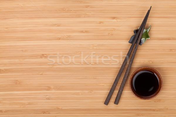 Sushi Çin yemek çubukları soya sosu çanak bambu tablo Stok fotoğraf © karandaev
