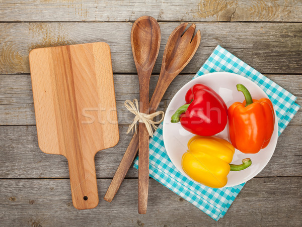 Colorful bell peppers and kitchen utensils Stock photo © karandaev