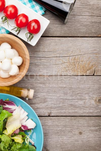 Fresh healthy salad, tomatoes, mozzarella Stock photo © karandaev