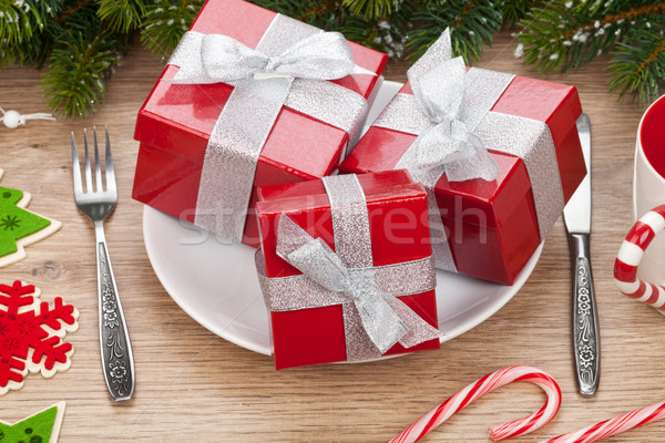 Gift boxes on plate, fir tree and christmas decor Stock photo © karandaev