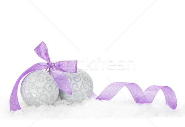 Christmas baubles and purple ribbon Stock photo © karandaev