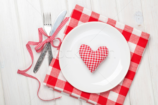 Valentines day heart shaped toy gift on plate with silverware Stock photo © karandaev